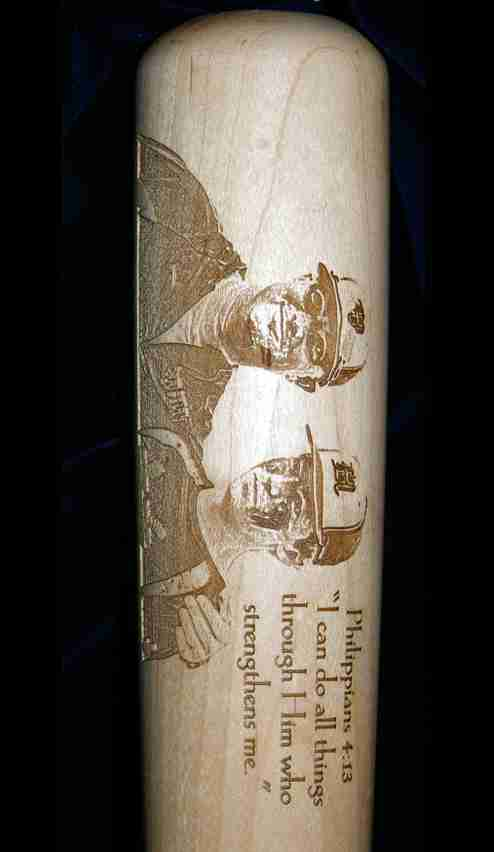 Horizontally oriented baseball bat with father and son photo engraving with wording
