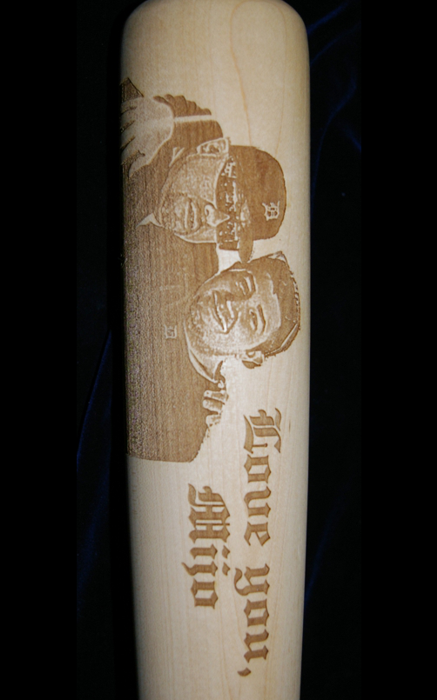Custom presentation bat with two people engraved and large wording engraved