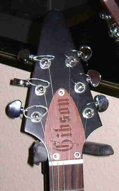 Faded vintage red stained truss rod cover