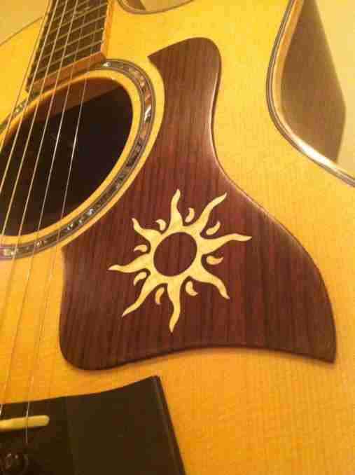Inlad sun graphic on indian rosewood on a taylor guitar