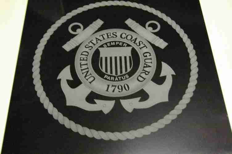Coast Guard graphic and rope design engraved into large marble square