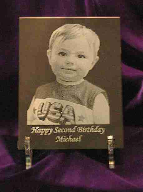 Child's photo placed on an 8 inch by 10 inch rectangular with wording centered under