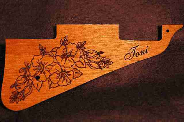 Custom flower graphic engraving on spanish cedar